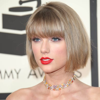 Taylor Swift arrives on the red carpet during the 58th Grammy Awards at the Staples Center.