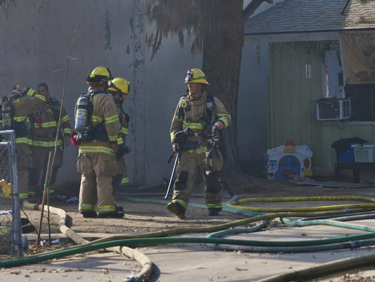 More than 20 firefighters were called to a house fire