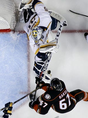 Nashville Predators goalie Pekka Rinne, top, blocks a shot by Anaheim Ducks center Rickard Rakell during the third period of Game 7 in the first round on April 27, 2016. The Predators won 2-1.