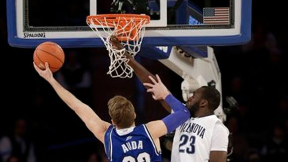 Seton Hall's Patrik Auda, left, sinks a shot past Villanova's Daniel Ochefu during the first half of an NCAA  college basketball game in the quarterfinals of the Big East Conference tournament at Madison Square Garden, Thursday.