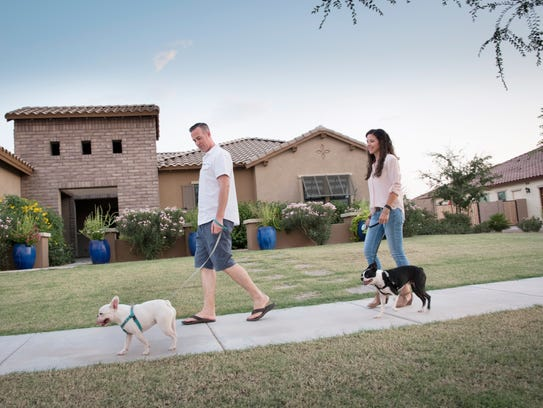 Linzie and Jared Smith, take their dogs, Mo, left and