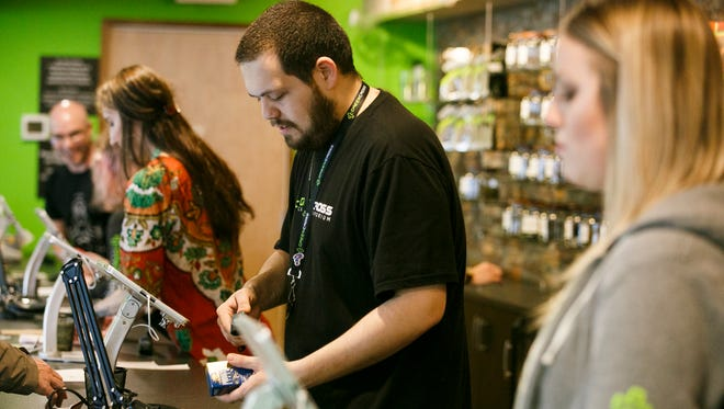 Employees at Green Cross Cannabis Emporium make sales at their 420 event on Thursday, April 20, 2017. The marijuana retailer hosted an all-day event with special deals, free food for the first 200 customers, and a DJ in the evening.