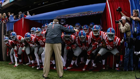 Ole Miss prepares to enter the field before the Sugar Bowl against Oklahoma State.