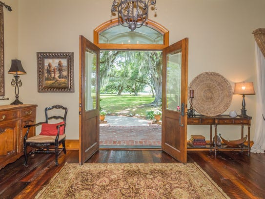 The grand entry features beautiful wood floors and
