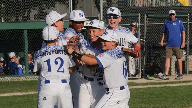 The Sioux Falls Little League team celebrates after beating Fargo on Monday in Rapid City to advance to the Midwest Regional tournament.