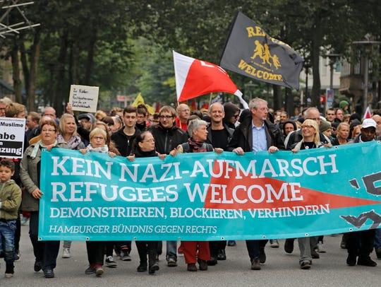 "Demonstrators   carry a banner that reads ""Kein Nazi-Aufmarsch"