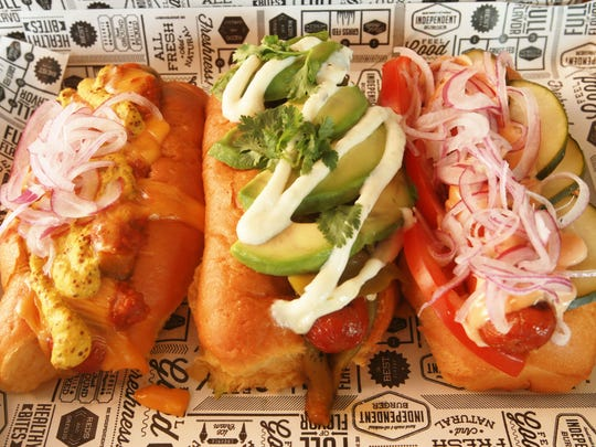Independent Burger offers delectable burges, but also features tasty hot dogs, including, left to righy, the Chili Cheese Dog, Green Chile Dodg and the Indy Dog.