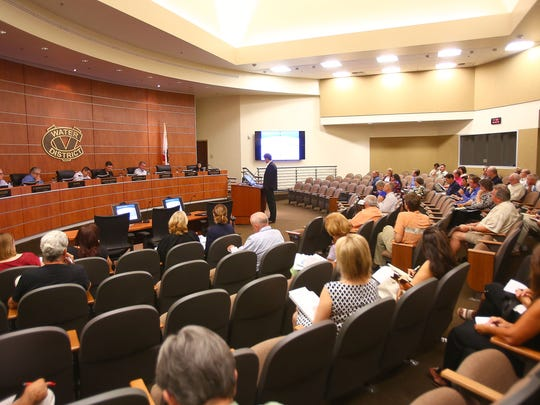 Customers of the Coachella Valley Water District attend a June 8 meeting, listening to a presentation about plans for raising rates.