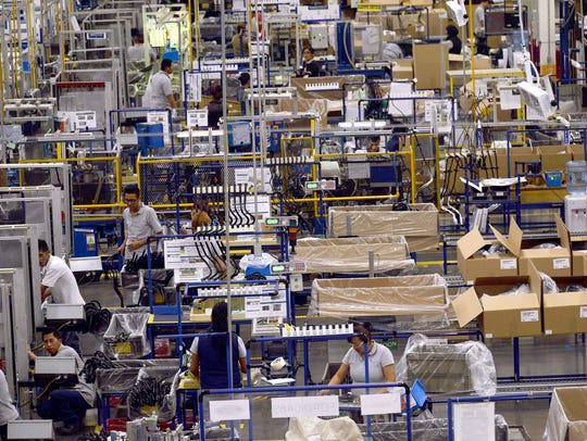 Workers in the auto parts production line of the Bosch