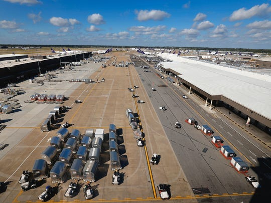 Mike Brown/The Commercial Appeal The ramp at the FedEx Hub at Memphis International Airport bustles with activity during the day sort of packages. October 18, 2016 - The ramp at the FedEx Hub at Memphis International Airport bustles with activity during the day sort. (Mike Brown/The Commercial Appeal)