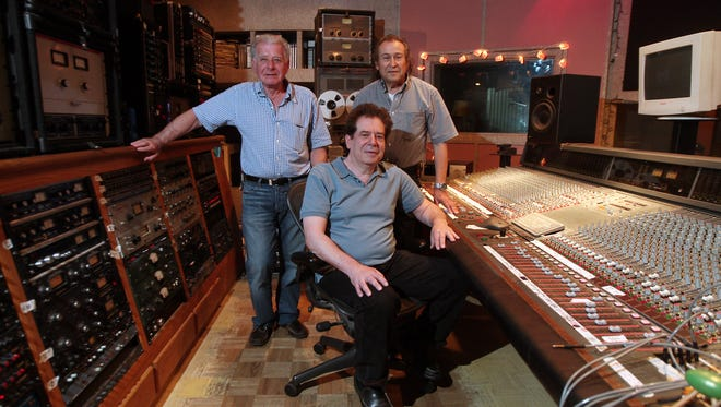 Steve Schiff, l, Ben Elliott, seated and Larry Gribler in Showplace Studios on the 40th anniversary of the Showplace in Victory Gardens. Once a showcase nightclub for headliner rock acts, of late, known more as a  go-go bar, but in the back is hidden an internationally known recording studio that has hosted Keith Richards, Eric Clapton and Steve Miller among many others. June 28, 2016, Victory Gardens, NJ