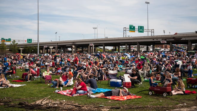 Crowds gather at Waterfront Park to watch planes fly during the 2015 Thunder Over Louisville Air Show in Louisville, Ky. April 18, 2015.