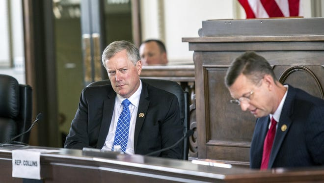 Reps. Mark Meadows, R-NC, and Doug Collins, R-GA, listen to testimony during the congressional subcommittee on government operations hearing on Operation Something Bruin at the Historic Haywood County Courthouse on Friday. The congressmen heard testimony from defendants and government agencies involved in the yearslong operation to combat bear poaching in Western North Carolina and Georgia.