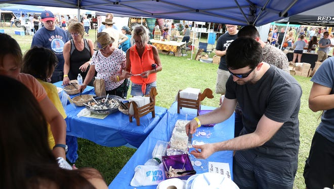 The Finger Lakes Cheese Festival brought more than 3,500 people to Sunset View Creamery in Odessa in 2015.