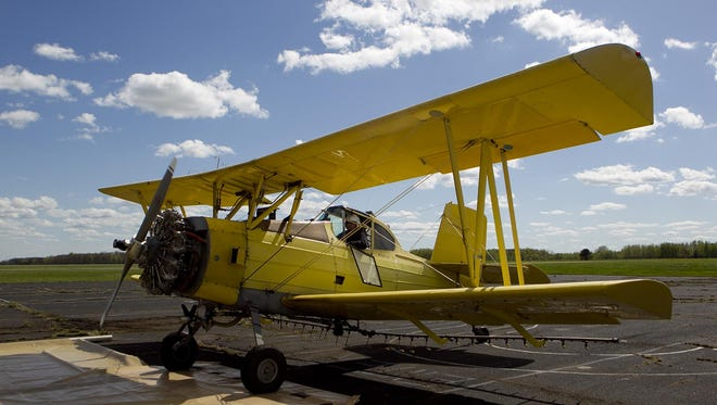 Ryan Ferris of Marengo, Ill., parks his yellow biplane at the Marshfield Municipal Airport for refueling in 2014.