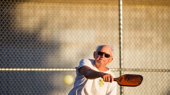 Earl Cunningham plays a game of pickleball on Friday,