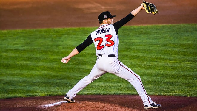 Shane Dawson of the Lugnuts pitches to a Whitecaps batter during their playoff game Monday at Cooley Law School Stadium in Lansing. Dawson gave up six runs on 11 hits in five innings and was the losing pitcher in a 14-5 game.