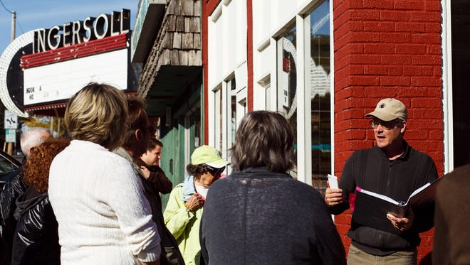 Tom Wollan of Des Moines leads an architectural walking tour of Ingersoll past the Ingersoll Theater at 3711 Ingersoll which is on the endangered buildings list on Saturday, October 10, 2015. Put out by the Des Moines Rehabbers Club in Des Moines, the list highlights buildings that are being neglected or risk demolition.