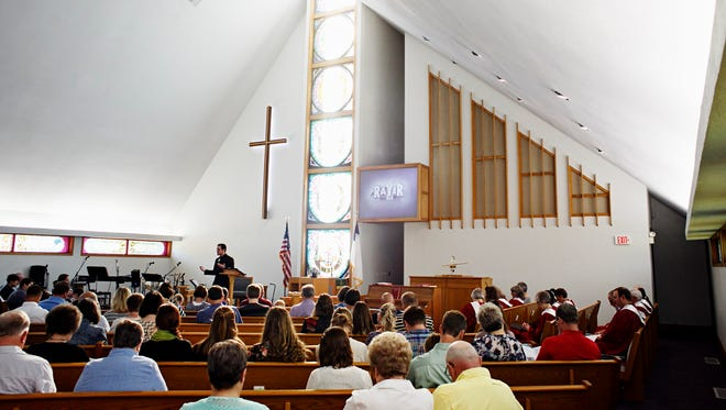 Pastor Tim Frasher  preaches during a service at Bloomfield United Methodist Church in Bloomfield on Sept. 13. One of the bigger churches in Davis County, Bloomfield United attends around 150 people each week, according to Frasher.