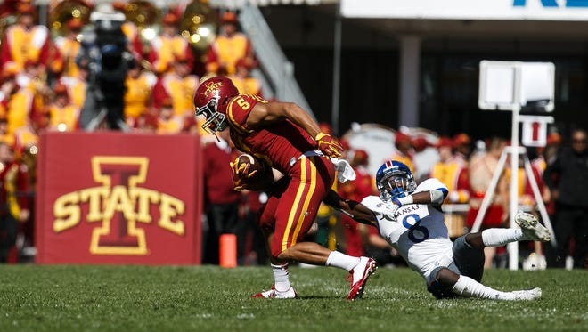 Iowa State's Allen Lazard is tackle by Kansas corner back Brandon Stewart during their game at Jack Trice Stadium in Ames on Saturday, October 3, 2015.