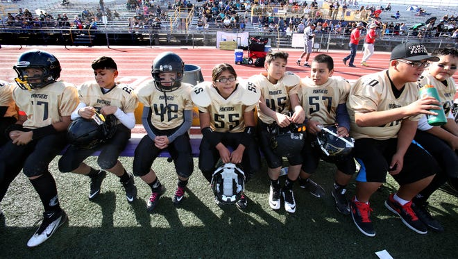 Members of the Central Panthers team, including Sophie Garcia, No. 55, rest on the sidelines during their Little Bowl semifinal game against the El Paso Bandits on Nov. 14 at Burges High School. The Panthers lost 20-14.