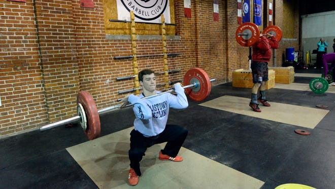 Lifters from White Rose Barbell practice the clean and jerk movement Monday, Nov. 30, 2015 at Crossfit York. (John A. Pavoncello - The York Dispatch)