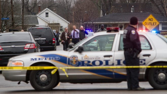 Police scan the scene of a police shooting in Shively on Friday morning. Jan. 9, 2015.