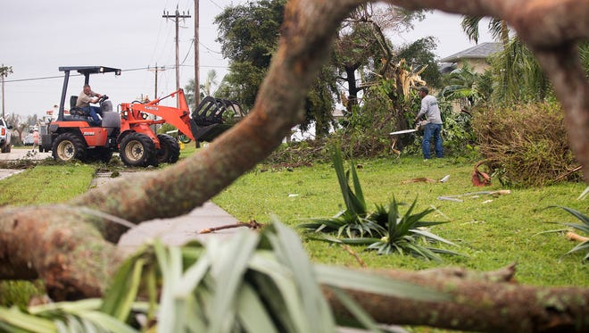 Scenes on Sunday of the aftermath of a tornado that struck several neighborhoods in Cape Coral late Saturday night.