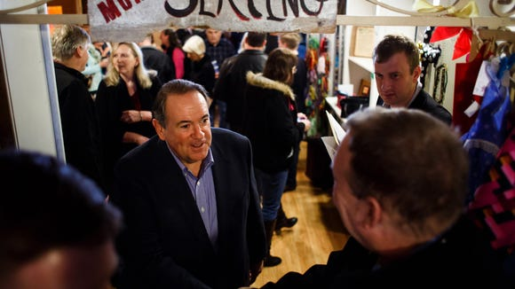 Mike Huckabee greets supporters at a campaign event