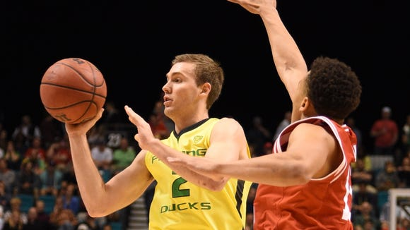 March 12, 2016; Las Vegas, NV, USA; Oregon Ducks guard Casey Benson (2) passes the basketball against Utah Utes guard Lorenzo Bonam (15) during the second half in the championship game of the Pac-12 Conference tournament at MGM Grand Garden Arena. Mandatory Credit: Kyle Terada-USA TODAY Sports