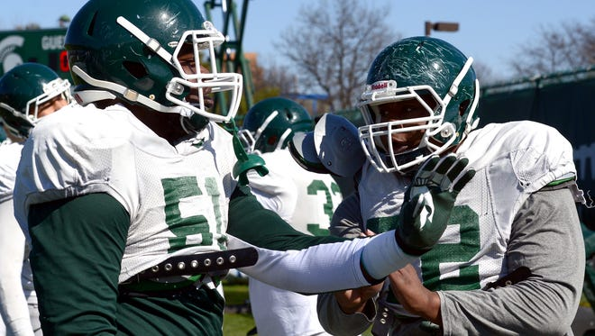 Defensive linemen Craig Evans (72) practices his technique on Kyonta Stallworth (51) as the Spartan football team practices Tuesday, April 6, 2016, at the  John and Becky Duffey Football Practice Fields on the campus of Michigan State University.