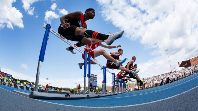 Boys compete in the 110 hurdles during the Iowa state track meet.