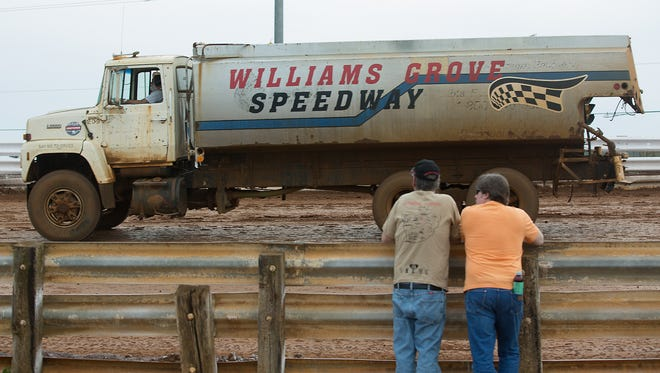 Fans watch the water truck at Williams Grove Speedway Friday, May 20, 2016.