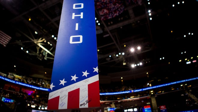 The signpost for the Ohio delegation features the signatures of delegates, not unlike a high school yearbook.