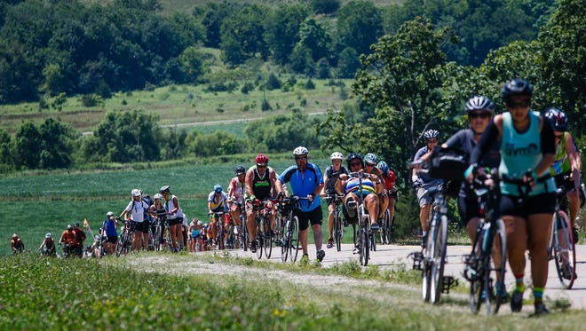 Riders battle up one of the many large rolling hills along the RAGBRAI route on Thursday, July 28, 2016 between Unionville and Blakesburg.