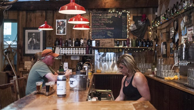 Marisa Nelson serves customers at Blacksmith Brewing on June 6.