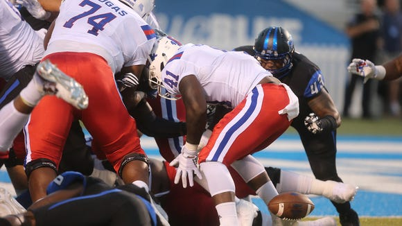 Louisiana Tech's Bobby Holly (41) fumbles the ball during the game against MTSU on Saturday, Sept. 24, 2016.