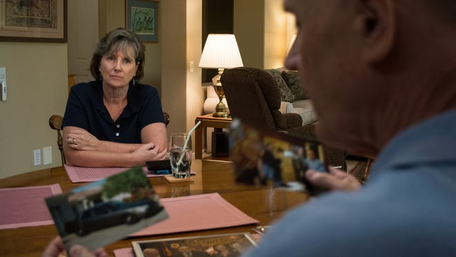 Brian Reilly sits with wife Denise among documents from his time as a member of Maricopa County Sheriff Joe Arpaio's Cold Case Posse, which investigated the authenticity of President Barack Obama's birth certificate.