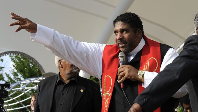 The Rev. William Barber, president of the North Carolina NAACP, speaks during the 2014 Mountain Moral Monday rally.