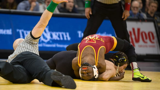 Iowa's Thomas Gilman twists Iowa State's Markus Simmons, scoring four points for a near fall at 125 pounds on Saturday, December 10, 2016 at Carver Hawkeye Arena. Gilman won 19-4.