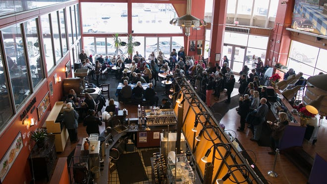 Dozens gathered for a rally at Spot Coffee, organized by Rochester Circle for Peace, in Rochester on Jan. 8, 2017.