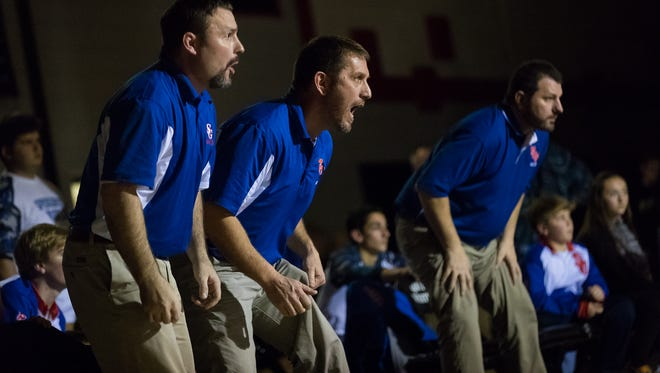 Tyke Conover (left) will take over for Tony Miller (center) as the head coach of Spring Grove wrestling.