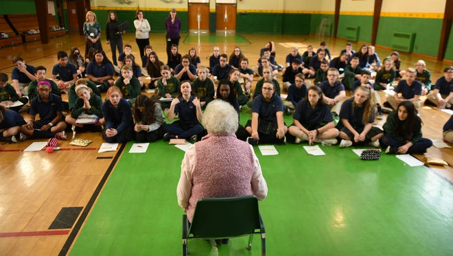 Annabelle Hornbaker talks to  Corpus Christi School students during an event on Monday, March 13, 2017. Hornbaker, 85, talked to kids about her many decades in the workforce.