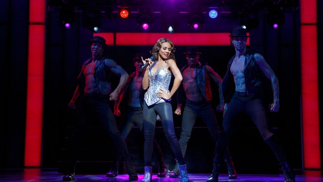 Deborah Cox as Rachel Marron, with Jaquez AndrŽ Sims, Brendon Chan, Willie Dee and Benjamin Rivera in The Bodyguard.