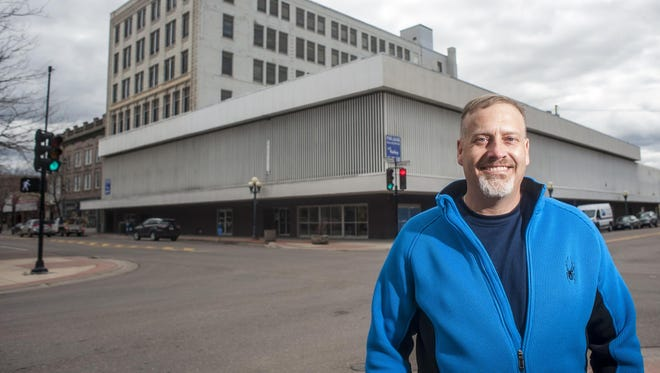 Great Falls developer Jason Madill is restoring the historic Strain Building that once housed department stores and the Great Falls Clinic and might remove its more recent steel-slatted facade to showcase its original architecture.