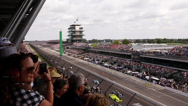 Cars whiz into turn one after the green flag is out at the 101st running of the Indianapolis 500 at Indianapolis Motor Speedway on Sunday, May 28, 2017.