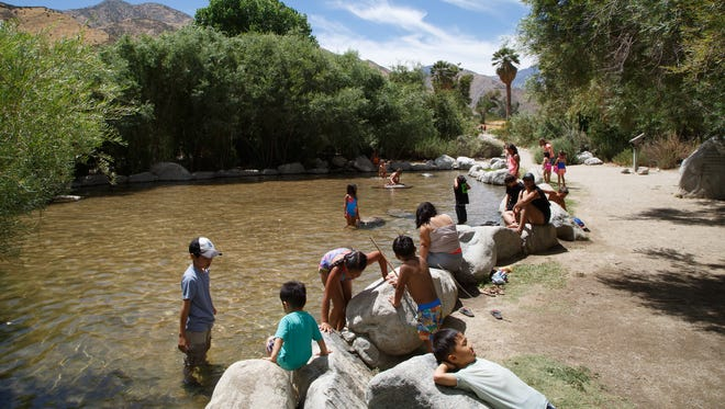 Children play in one of Whitewater's pools at Whitewater Preserve, Saturday, June 10, 2017.