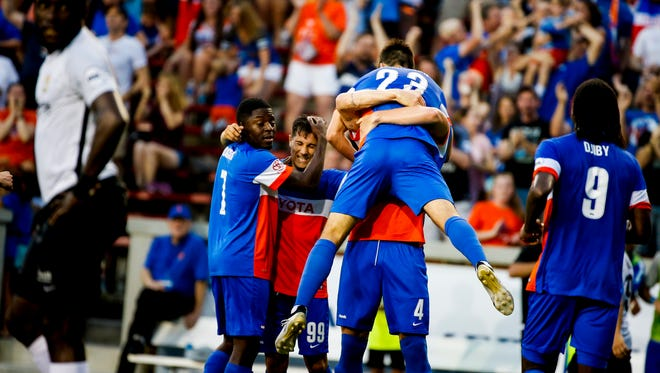 FC Cincinnati's Andrew Wiedeman (23) celebrates scoring a goal to tie up the score in the second half of the match between FC Cincinnati and Charleston Battery at Nippert Stadium in Cincinnati on Saturday, June 17, 2017.