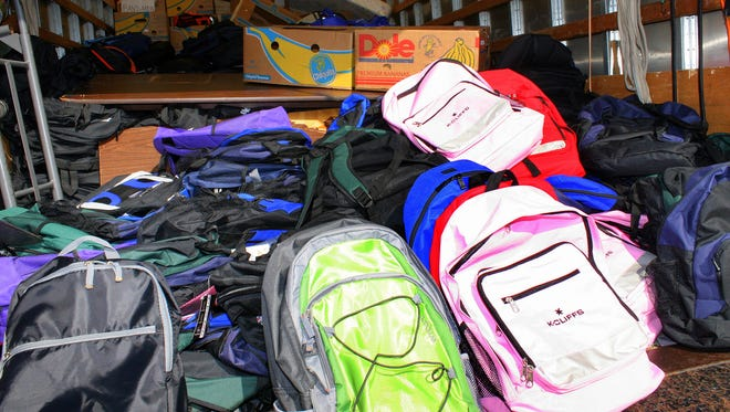 A truck filled with backpacks and other goods sits ready at the Big Backpack Giveaway organized by GraceWorks Ministries in Franklin.