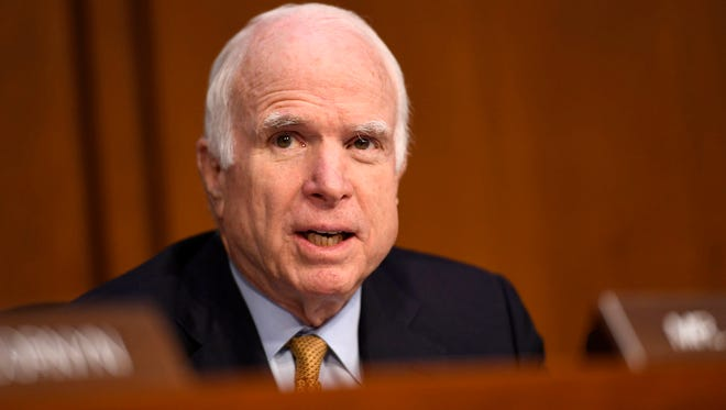 Sen. John McCain, R-Ariz., speaks as former FBI director James Comey testifies in front of the Senate Intelligence Committee in Washington on June 8, 2017. Medical reports about the nature of a blood clot removed from above McCain's eye could answer whether McCain's confused questioning of Comey was an early warning.